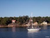 Houses and sailing ship